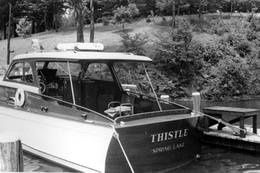 The yachtsman's dream, one's own boat dock. To go with Cracker Box Manor was a much reduced Thistle, a Chris Craft Commander and the last of Chet's Chris Crafts. It recalled the glory days of a half century earlier only in name, the lake it cruised and the fact that it floated. It was a lot of fun, though, and much less maintenance than a steam yacht.