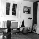 The appliances of the 1950's. Especially note the television, probably black and white.