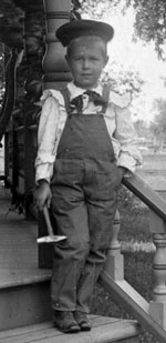 Chester at his mother's relatives' home in the Champaign area. He's holding a hammer in his hand; he was always handy with tools and kept a workshop all of his life, but at this age wielding such an instrument generally meant trouble.