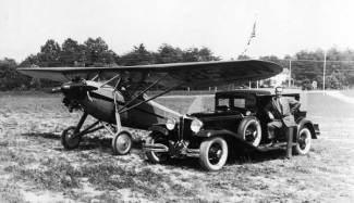 "Chet with his two loves and livelihoods, the airplane and the car. Photo taken at Congressional Airport in May 1930. The plane is a Davis D-1; Chet was a Davis dealer as well as a Stinson one, and he took his pilot's licence test in a Davis. His Davis ""lot"" was at Congressional."
