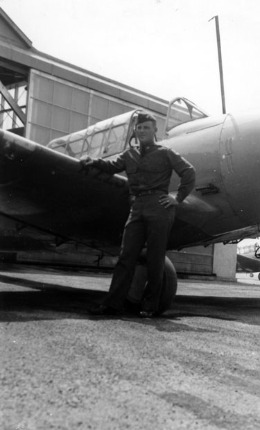 Gaston next to his BT-15 trainer, 9 May 1942.