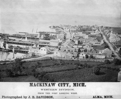 Mackinaw City during the 1860's. At the opposite end of Lake Michigan, every ship entering or leaving the lake had to pass by the city and through the Straits of Mackinac. The Straits beckoned Chicago yachtsmen for a lake-long race, but it wasn't until 1898 that the Chicago Yacht Club first organised such a race.
