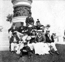 Well, most of us are having a good time: George Warrington (top) and friends stop for a group photo at the Civil War monument to the Union at Washington Park in Michigan City, Indiana. Michigan City was and is a convenient holiday destination from Chicago. Since many in the party are in their boating uniforms, I suspect they arrived by one or more of their yachts. The monument was donated to the city in 1893, so it was fairly new when this photo was taken. At the very bottom was Chester, who wasn't quite as enthusiastic about the adventure as the rest of the party. In an era when the idea was for children to be seen and not heard, Chet broke the mould and had quite an attitude, one which was indulged by his mother, who is sitting behind him.