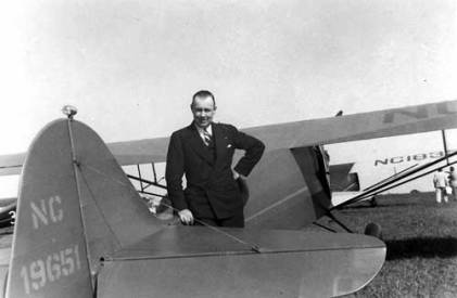 "Chet and his Taylorcraft ""A,"" NC-19651. In 1937 Chet competed in a Taylorcraft, one of the many competitions Chet entered in."