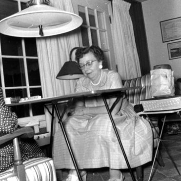 """Ted Steinhauer at Cracker Box Manor, 1957. The """"red table"""" she's sitting at is still in existence and plays its part in the development and maintenance of this website."""