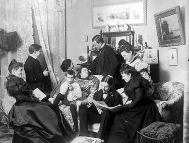 Partying, Victorian style. Looks more like a family gathering.