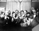 Partying, Victorian style. It has the look of a New Year's celebration.