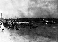 Looking out onto the field, with the military band to the left. The Texaco plane was flown by Duke Jernigan and Jim Wheeler.