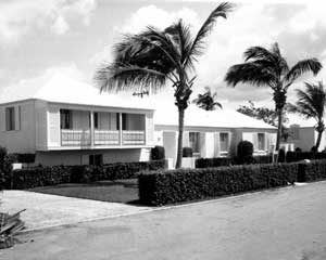 "Our home in Palm Beach. It was located on the old ""Dodge Estate,"" one of the last of the large estates to be broken up (Donald Trump's Mar-a-Lago is an example of one that is still intact.) Built in the late 1950's, it survived the hurricanes that were reasonably frequent during the years we lived in Palm Beach (we experienced two the first summer we lived there.) All of the windows were fitted with shutters (as shown here) or had a metal shield that could be fitted for a blow. This obviated the need to strip forests for plywood every time a hurricane arrived. Note also the ficus hedge running along the street. Using a hedge to both close in the yard and to obscure the view of the property (they're generally higher now than they were then) is fairly common in Palm Beach. After living with this, being forced into the ""open yard"" mould so common in the U.S. (especially in the South) just doesn't quite cut it."