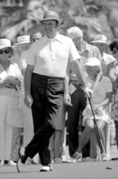 "Sam Snead, waiting to putt. Raised in Virginia mountain poverty (which explains his reputation for thrift,) ""Slammin' Sam's"" swing was one of the smoothest ever in professional golf, and watching him play was a joy."