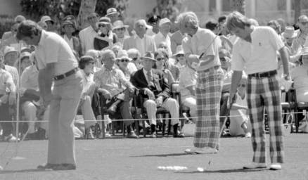 Showing how it's done before teeing off. The golfers, right to left: Dave Marr, Jack Nicklaus, Ben Crenshaw.
